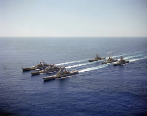 An aerial port bow view of six nuclear-powered guided missile cruisers underway in formation during Exercise READEX 1-81. The ships are, from left to right, front row: USS CALIFORNIA (CGN 36), USS SOUTH CAROLINA (CGN 37), USS VIRGINIA (CGN 38); second row, USS TEXAS (CGN 39), USS MISSISSIPPI (CGN 40) and USS ARKANSAS (CGN 41).